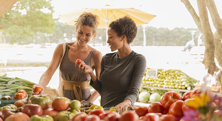 two women shopping the sarasota bayfront farmers market