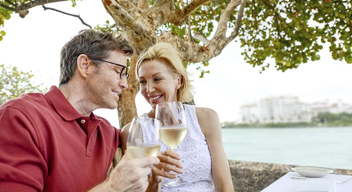 couple smiling and having picnic in front of sarasota's marina