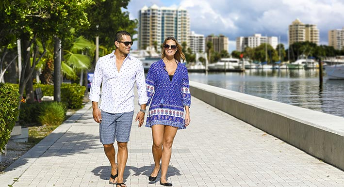 couple walking the sarasota marina
