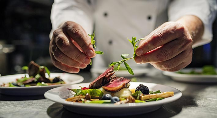 chef plating a salad