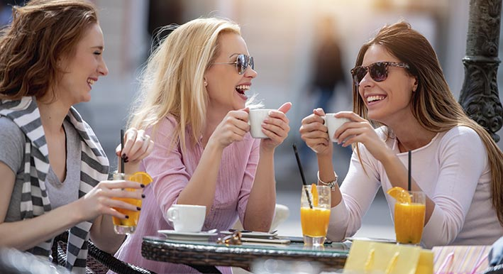 three women having brunch near bayso sarasota
